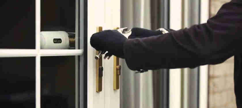 burglar breaking into french doors