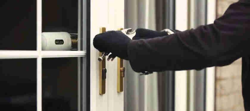 burglar breaking into french doors