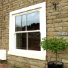 Vertical slider windows finished in traffic white
