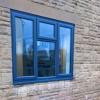 casement windows in signal blue